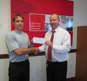 Banking Center Manager Andy Hullender Presents Executive Director Eric Bucey with a $2,500 Grant